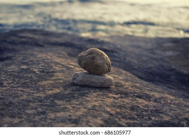 Round pebbles on the beach.