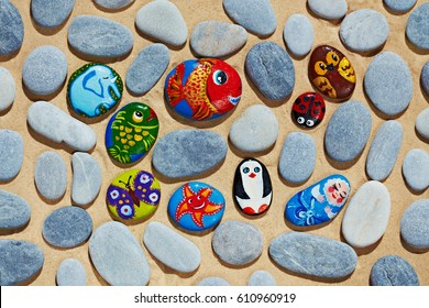 Round pebbles stones from sea vacation painted, souvenir made by kid