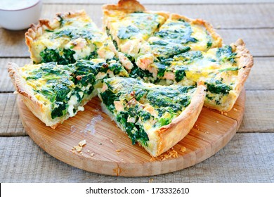 Round PIE with spinach and fish, food closeupop