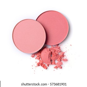 Round pink blusher and crashed eyeshadow for make up as sample of cosmetic product isolated on white background