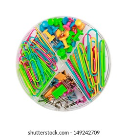 Round plastic box with paper clips and push-pins
