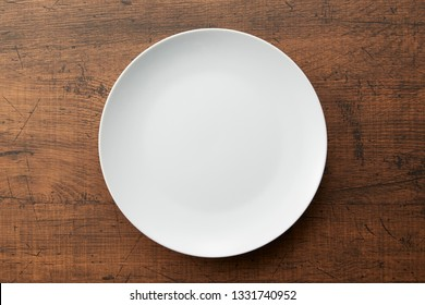 round plate isolated on wooden background