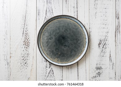 Round Plate on white wooden table background