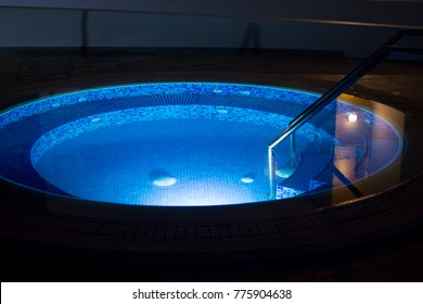 Round pool with blue illumination.