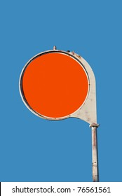 Round red old gas station sign with blue sky