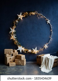 a round ring decorated with stars and lights for the new year, a place for a photo shoot for Christmas, a new year's interior design concept