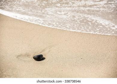 round rock on sandy beach