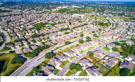 Round Rock , Texas , USA aerial drone view high above Suburb Neighborhood with Vast amount of Homes