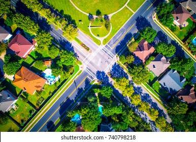 Round Rock , Texas , USA Suburb growing outside of Austin high aerial drone view green end of summer colorful morning Millions of Homes Neighborhood Suburbia straight down 4 way stop