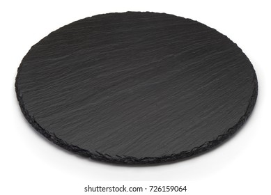 Round rustic black slate stone plate, isolated on white background