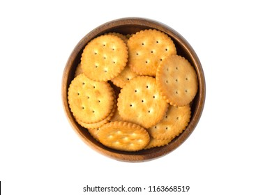 Round salted cracker cookies in wooden bowl isolated on white background.
