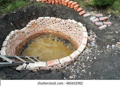 Round septic tank with red bricks