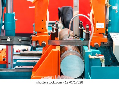 Round shaft steel is being cutting by automatic continuous and high speed horizontal band saw machine for industrial