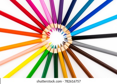 A round shape to center arrangement Color pencils isolated on white background with rainbow style close up.