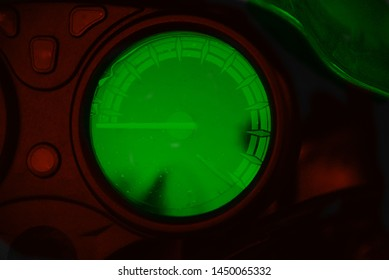 A round shape green odometer of a motorbike