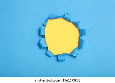 round shape hole in colored cardboard, empty space for advertising text in torn paper, background texture