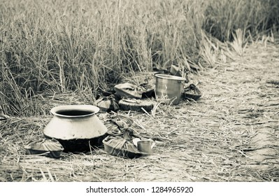 Round shape metallic food pots kept around an agricultural field