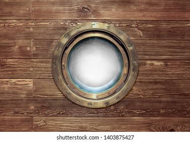 Round ship porthole in a bronze frame for a concept on a sea voyage on the yacht in retro style. Porthole window with brass border and glass with space for your photo at wooden backdrop.