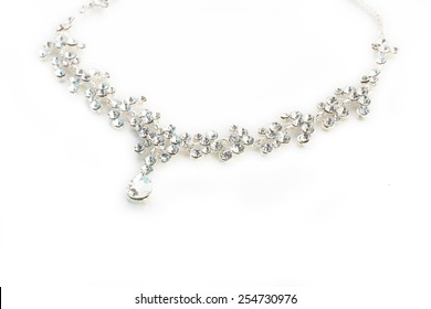 A round silver metal necklace with crystal, isolated on white background, closeup