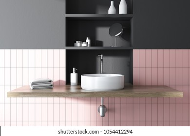 Round sink in a pink tiled and black bathroom interior with wide toiletry shelves behind it. 3d rendering mock up