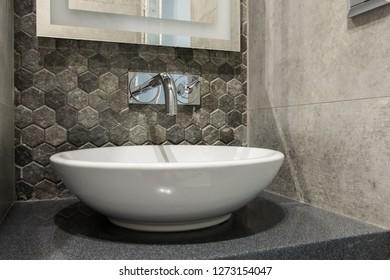 Round sink in toilet room