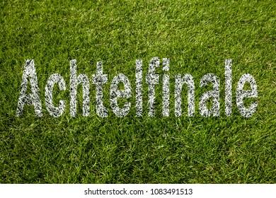"""Round of sixteen"" (in German) written on a soccer meadow"