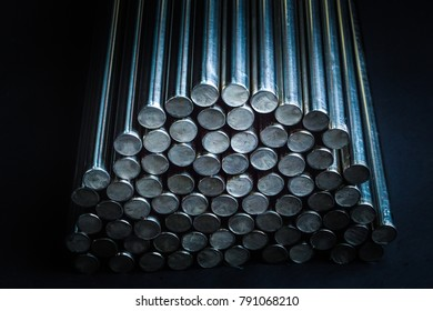 Round steel bars. Metallic Bars on Black Background. metallic texture pattern tech innovation concept background.