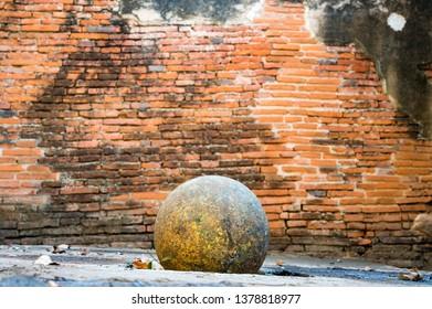 Round stone buried on bricks wall