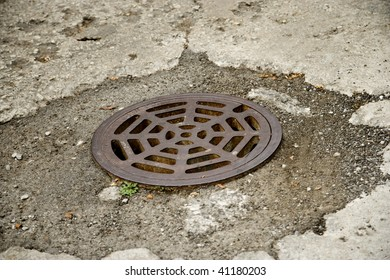 Round Storm Drain in the Road