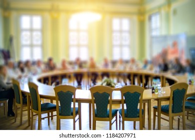 Round table meeting. Photo blurry