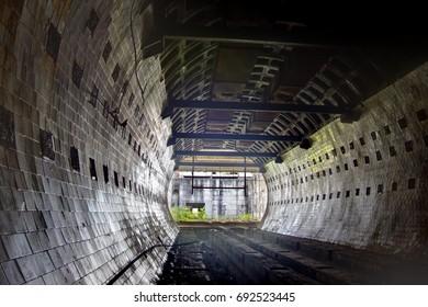 Round tiled tunnel in abandoned underground nuclear physics laboratory, Sukhum, Abkhazia