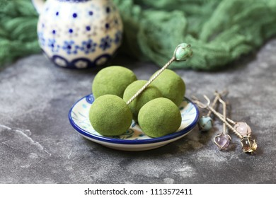 Round truffle candy with green tea matcha. Selective focus.