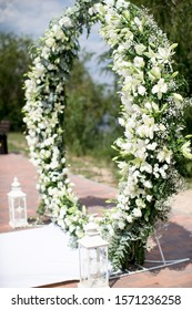 round wedding arch decorated with white flowers