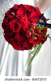 round wedding bouquet of red roses