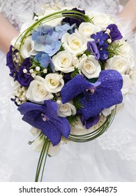 round wedding bouquet of violet and white flowers