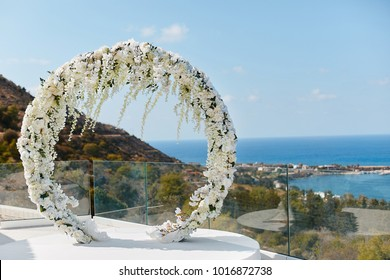 Round wedding floral arch from fresh flowers outdoors - wedding decoration