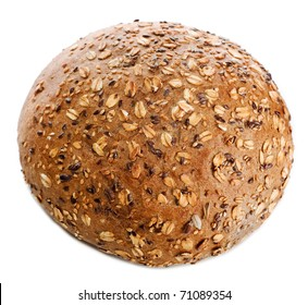 round White baked bread roll soft fresh with a crisp poured by a sesame and oatsflakes isolated on a white background