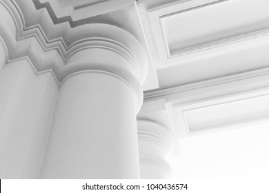 Round white columns with portico, abstract white classic interior fragment