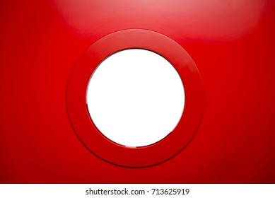 round white porthole in the red door.Copy space.