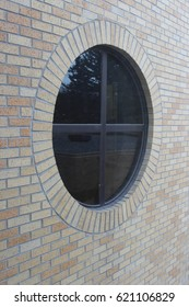 Round Window in Brick Building
