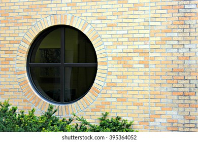 Round Window on Brick Building