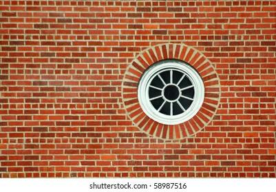 Round window on brick wall