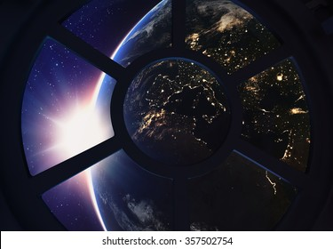 A round window on a space station with a view of Earth below