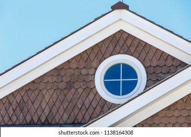 round windows on cottage facade
