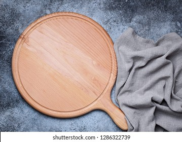 Round wood platter with handle. Kitchen accessories for serve. Top view with copy space