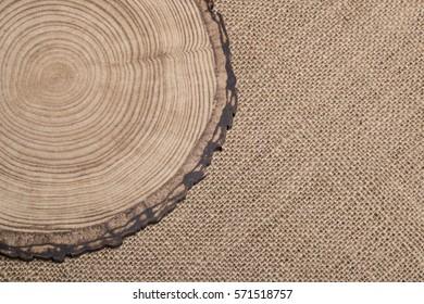 round wood slice on brown hessian