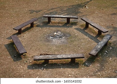 Round wooden chair for campfire.