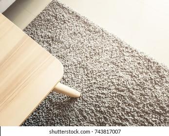 round wooden coffee table onrug interior background