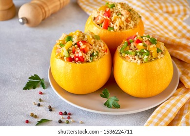 Round zucchini stuffed with bulgur and vegetables. Close up with copy space