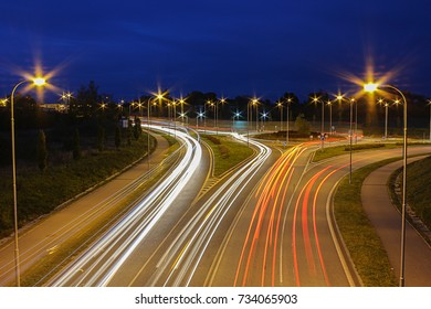 Roundabout in night on long exposure with car trails